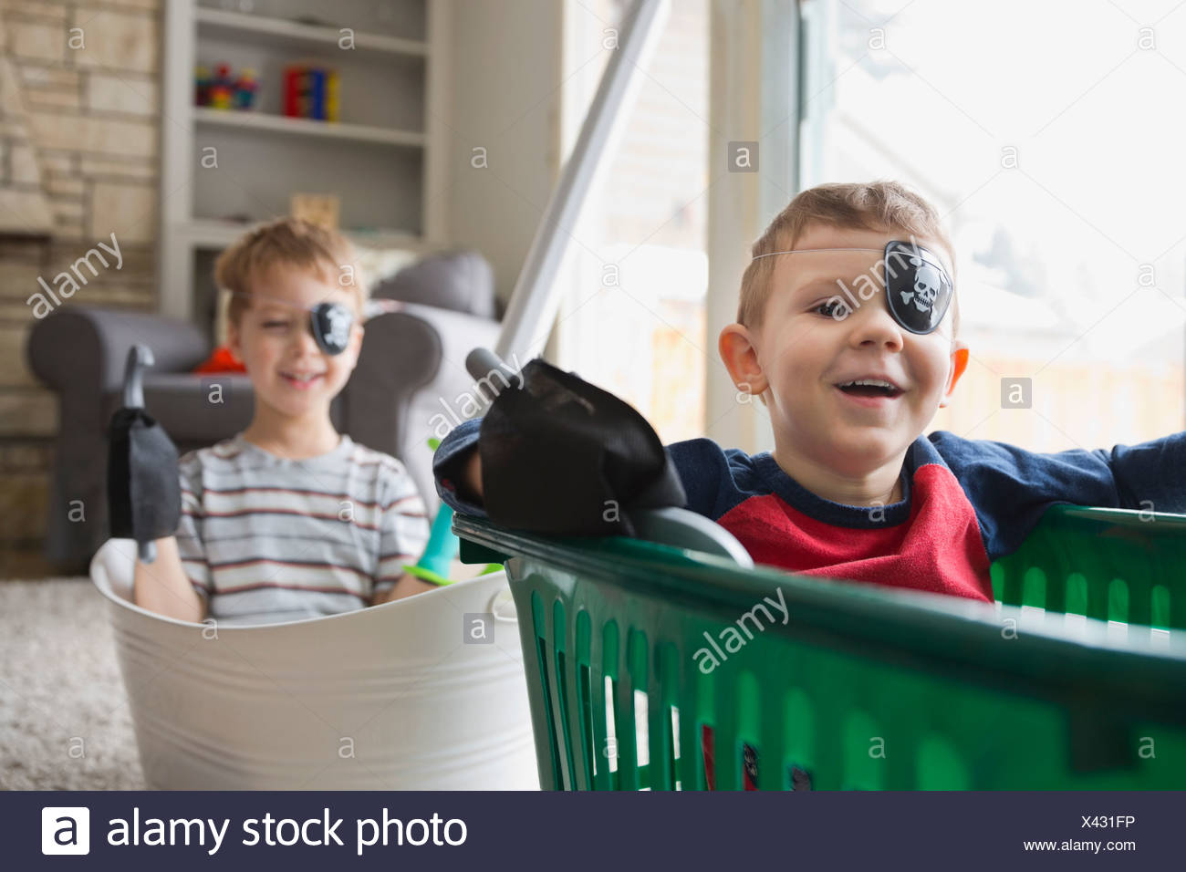 Portrait of boys dressed as pirates - Stock Image