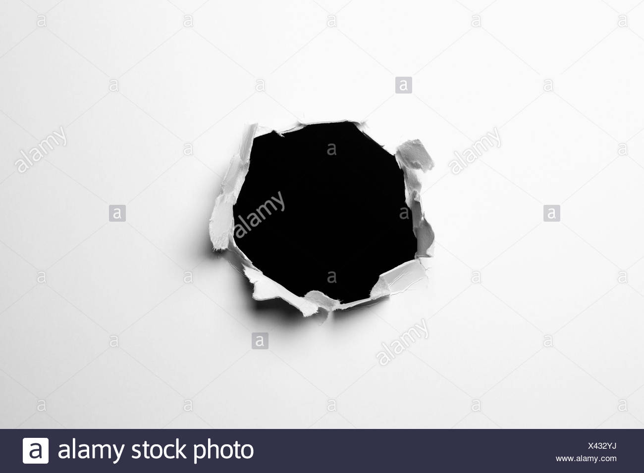 A hole in a wall - Stock Image