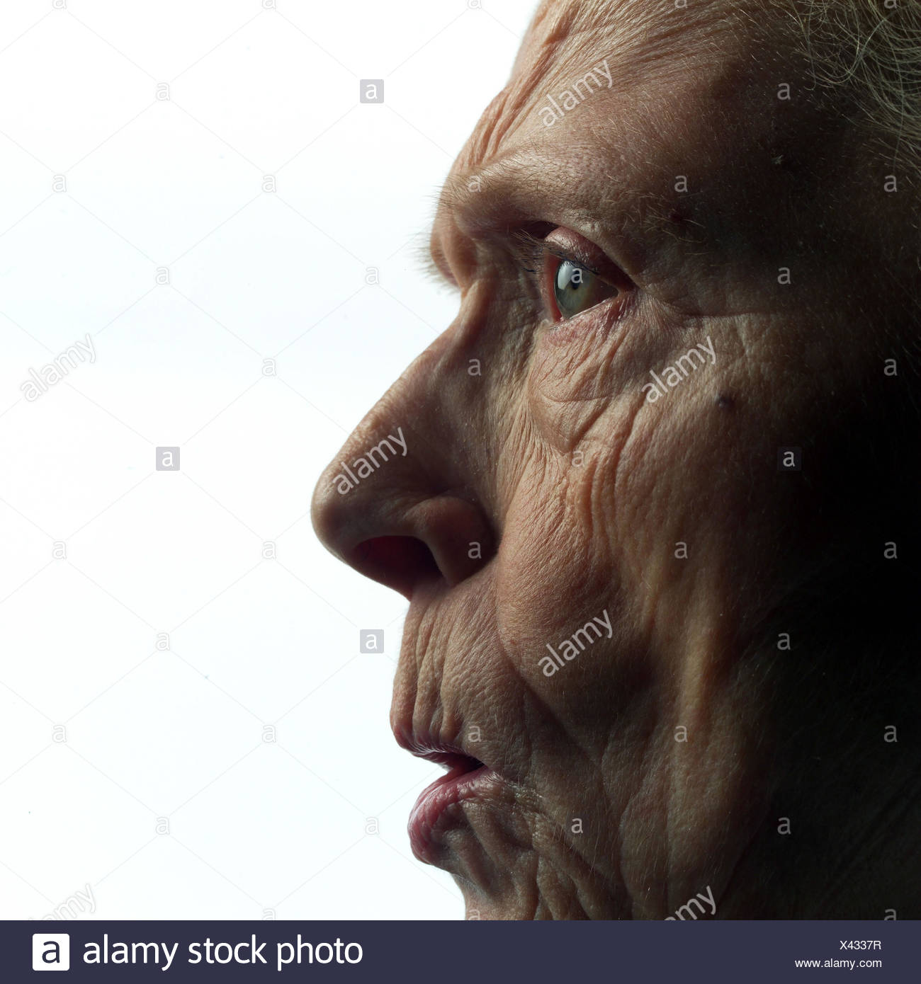 Senior, annoys, tread, detail, model released, studio, cut out, pensioner, woman, old, old age, look, shell, creased, folds, strictly, outrages, outrages, annoys nastily, furiously, get angry, expression, facial play Stock Photo