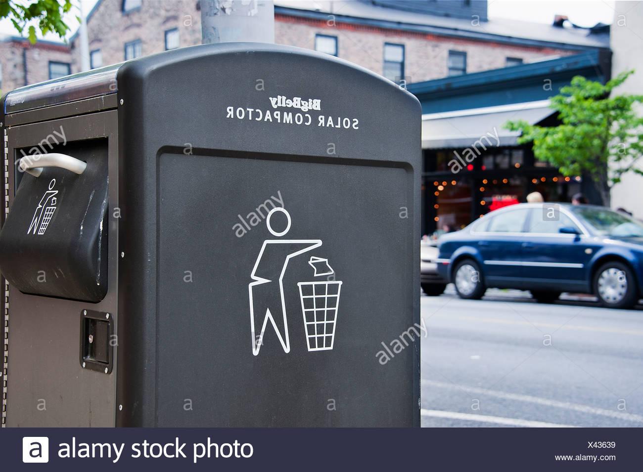 Public solar compactor trash receptacle, Manayunk, PA, USA - Stock Image