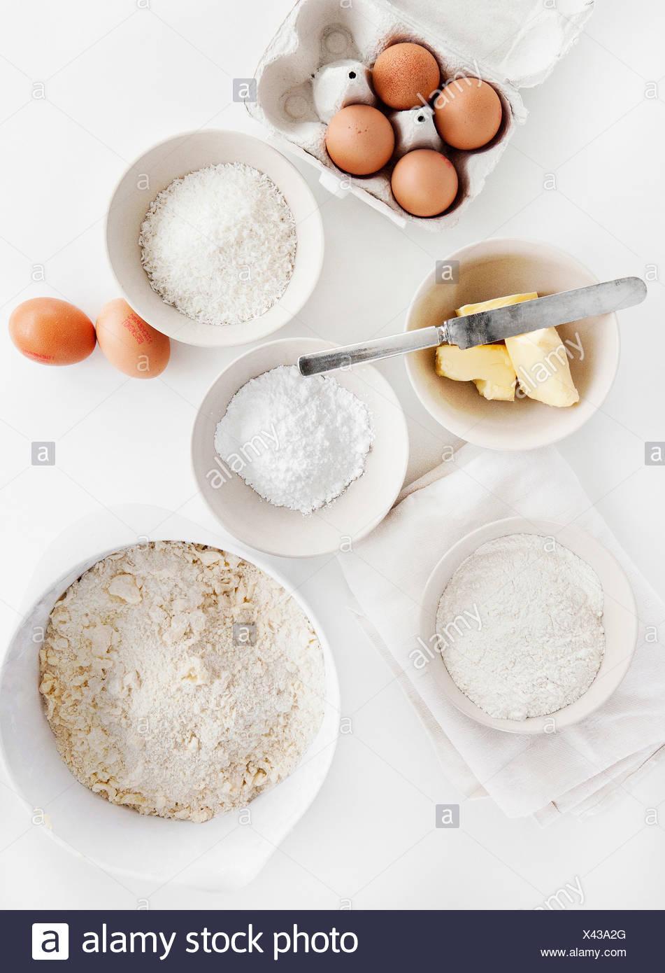 Bowls of sugar, flour, eggs, butter Stock Photo