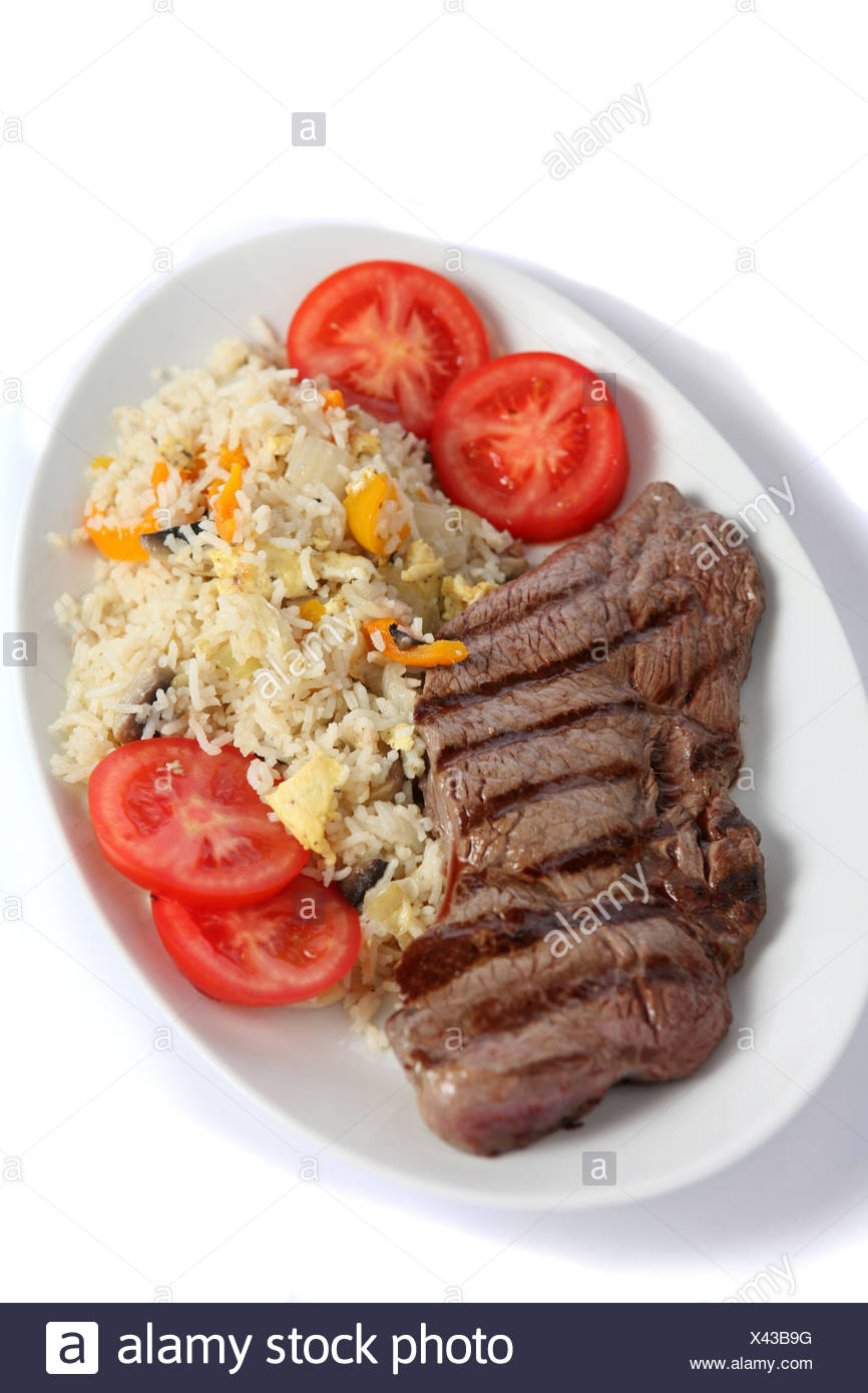 A meal of grilled steak with vegetable fried rice,a  fusion of eastern and western tastes. Stock Photo