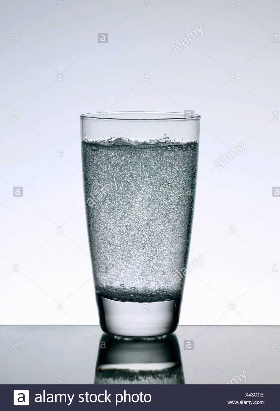 Close up of glass of sparkling water - Stock Image