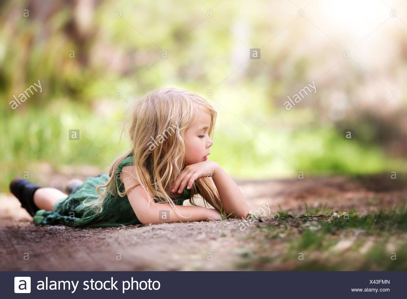Girl (4-5) on path - Stock Image