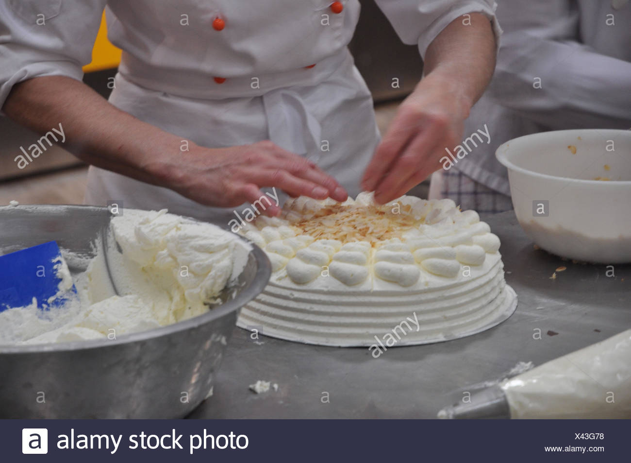 Occupation, confectioner, hands, cake, decorate, - Stock Image