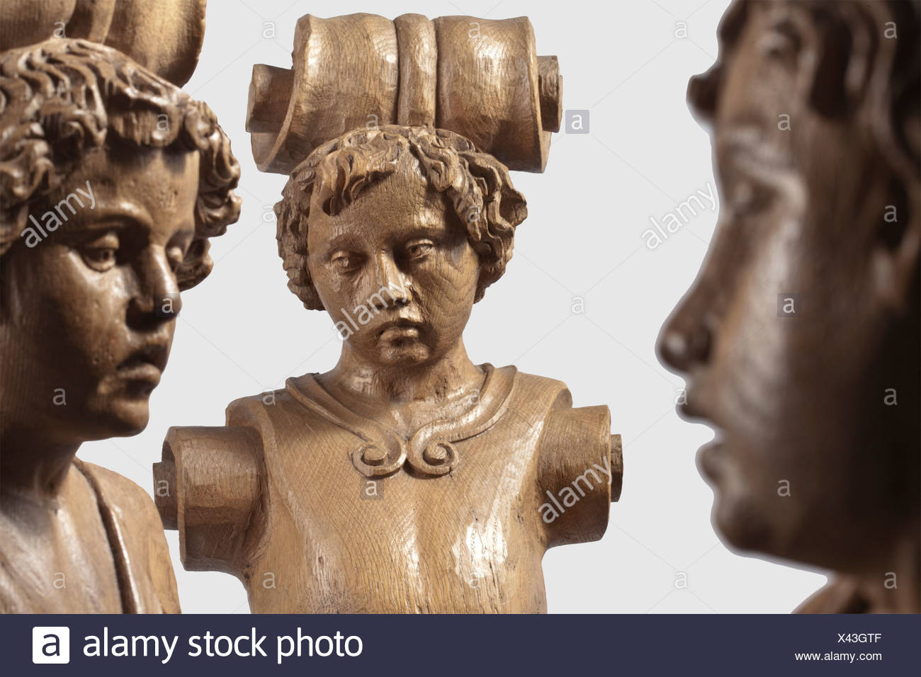 Three German caryatid pillars, 19th century in the style of the 17th century Elaborately carved, three quarter relief oak pillar overlays. Slightly different pillar figures in the shape of youths in ancient dress. The bases of each in the shape of massive volutes. Height of each 96 cm, historic, historical, people, 19th century, handicrafts, handcraft, craft, object, objects, stills, clipping, clippings, cut out, cut-out, cut-outs, sculpture, sculptures, statuette, figurine, figurines, statuettes, fine arts, art, Additional-Rights-Clearences-NA - Stock Image