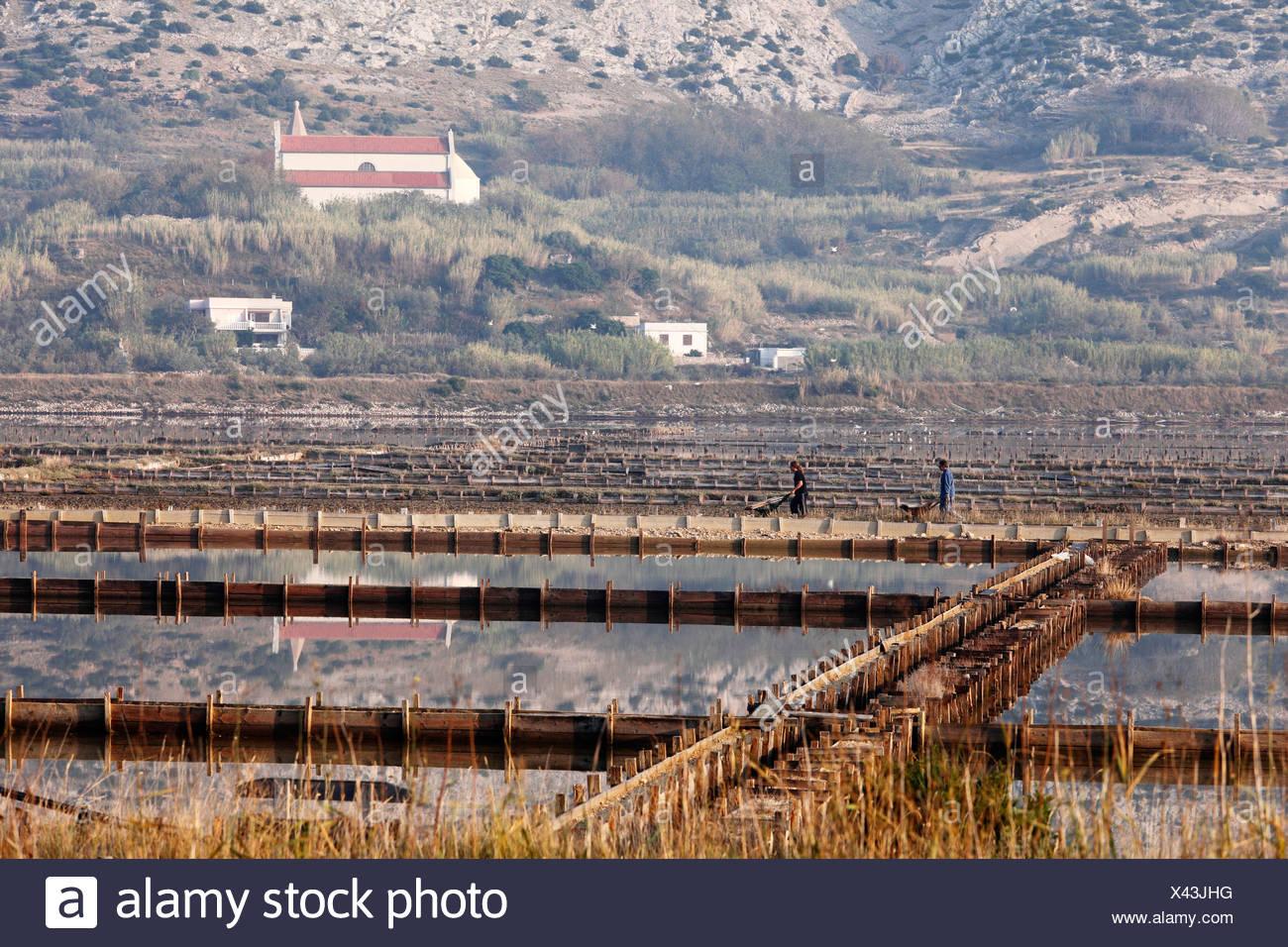Salinas and Stari Grad, Pag island, Dalmatia, Adriatic Sea, Croatia, Europe - Stock Image