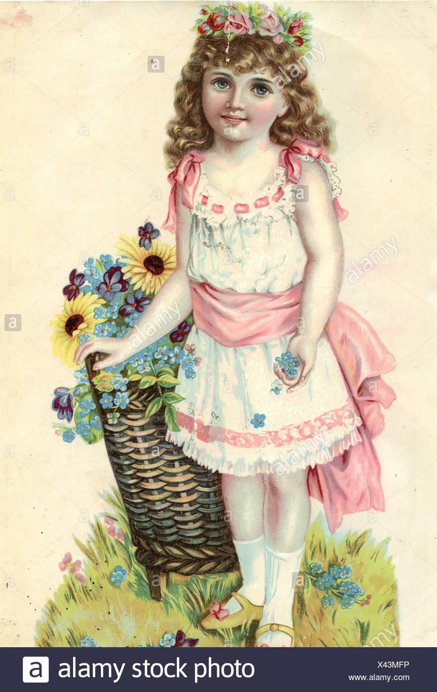 Young Girl with Floral Headress, Pulling a Basket of Flowers Stock Photo