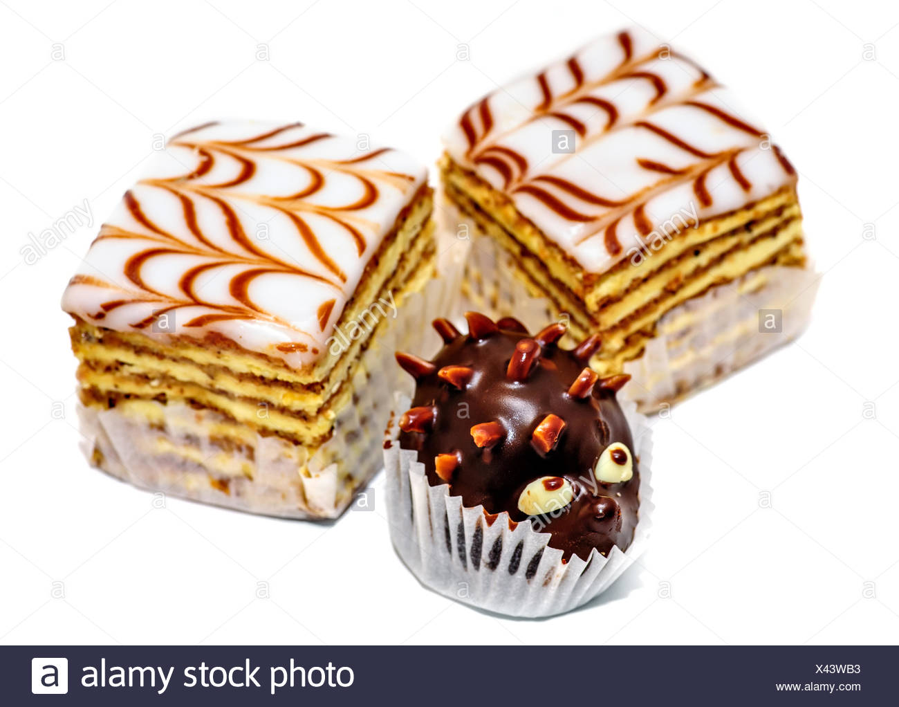 Layered cakes and chocolate hedgehog isolated - Stock Image