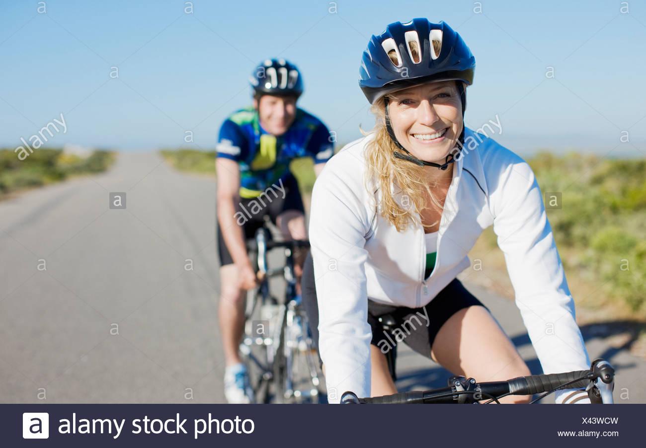 Couple bike riding in remote area - Stock Image