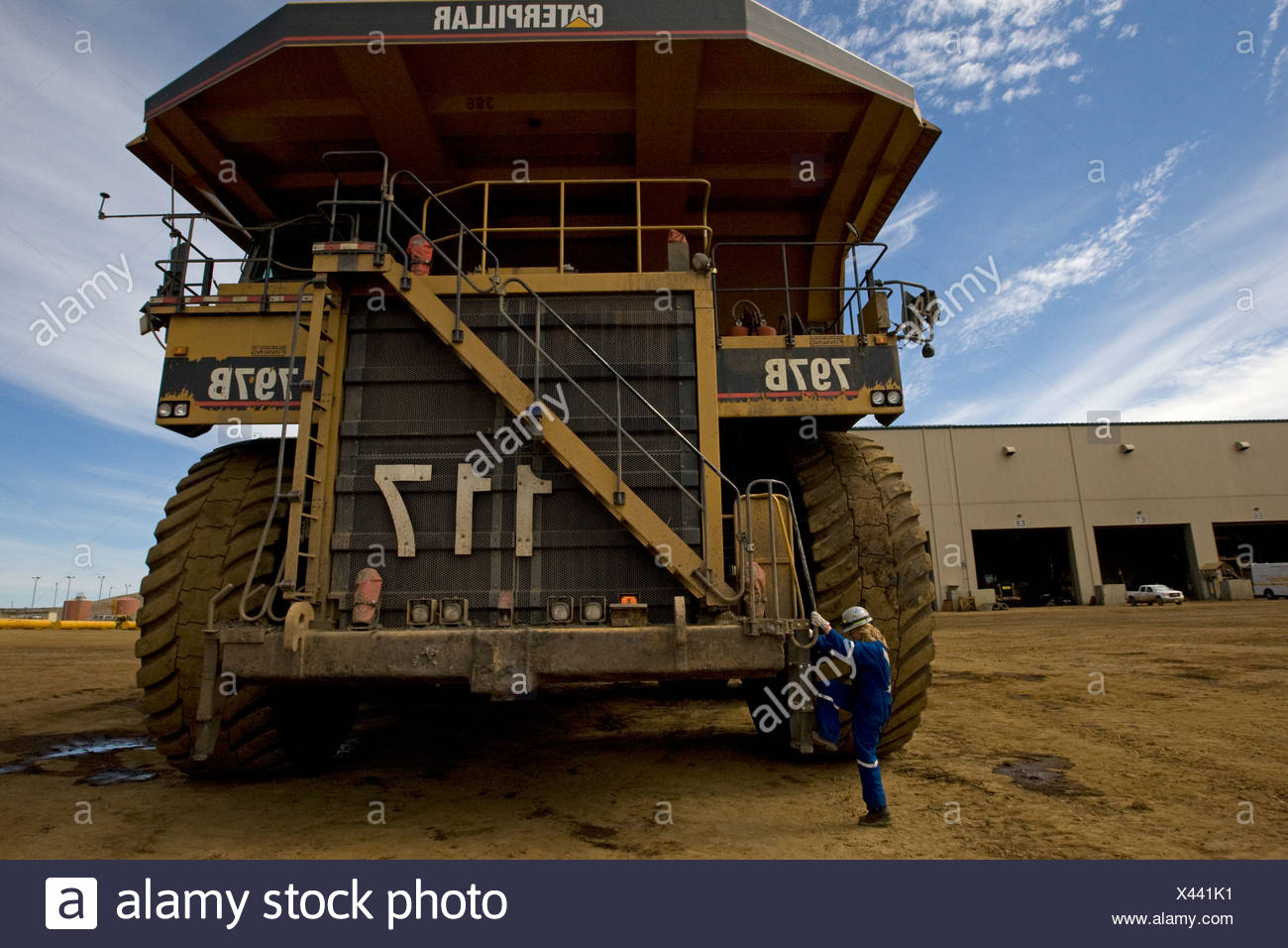 400 ton truck and driver, Albian Sands Oil Sands Mine, Fort McMurray, Canada - Stock Image