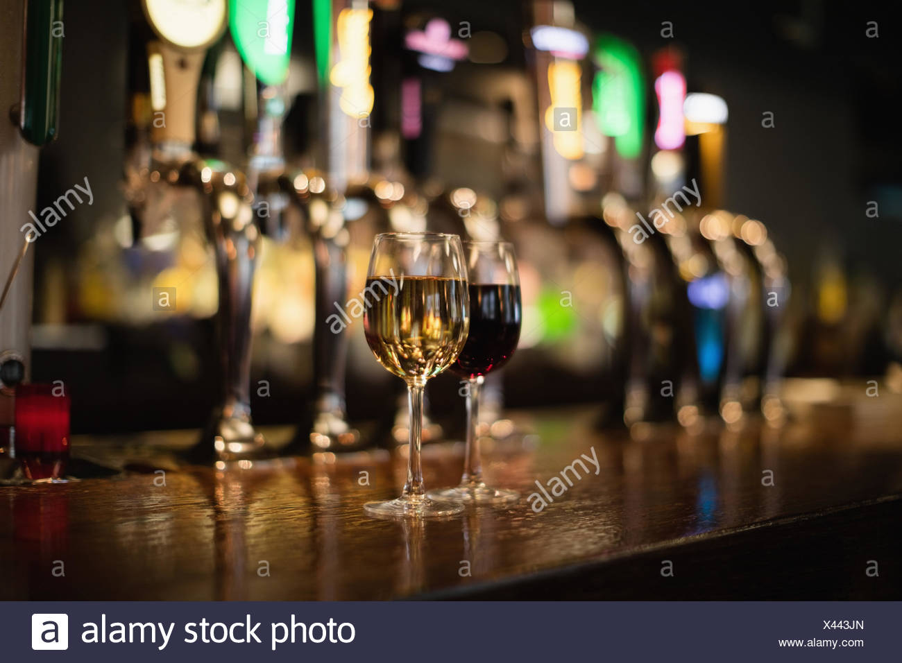 Two glass of red wine on bar counter - Stock Image