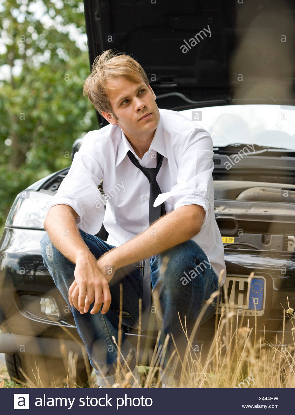 young man,waiting,vehicle breakdown,car driver - Stock Image