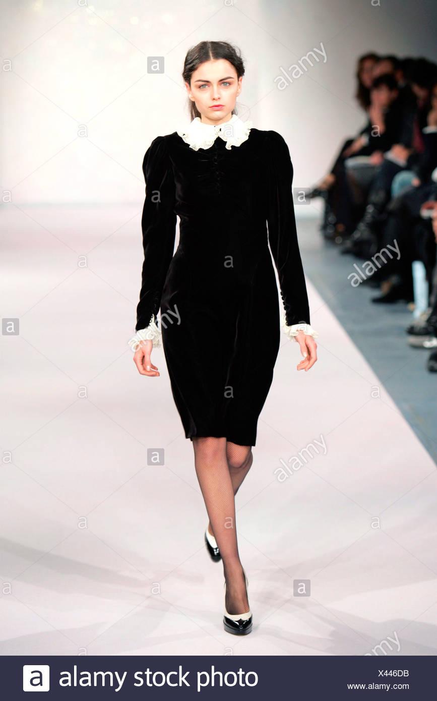 Black velvet long sleeved knee length dress with white frilly trimming ca4e7ca65
