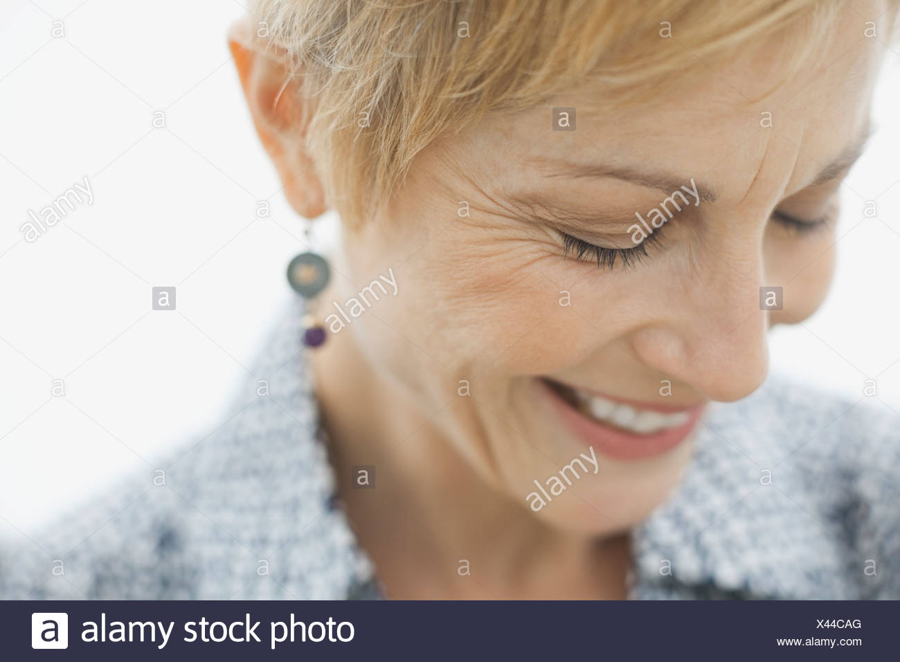 Close-up of smiling woman - Stock Image