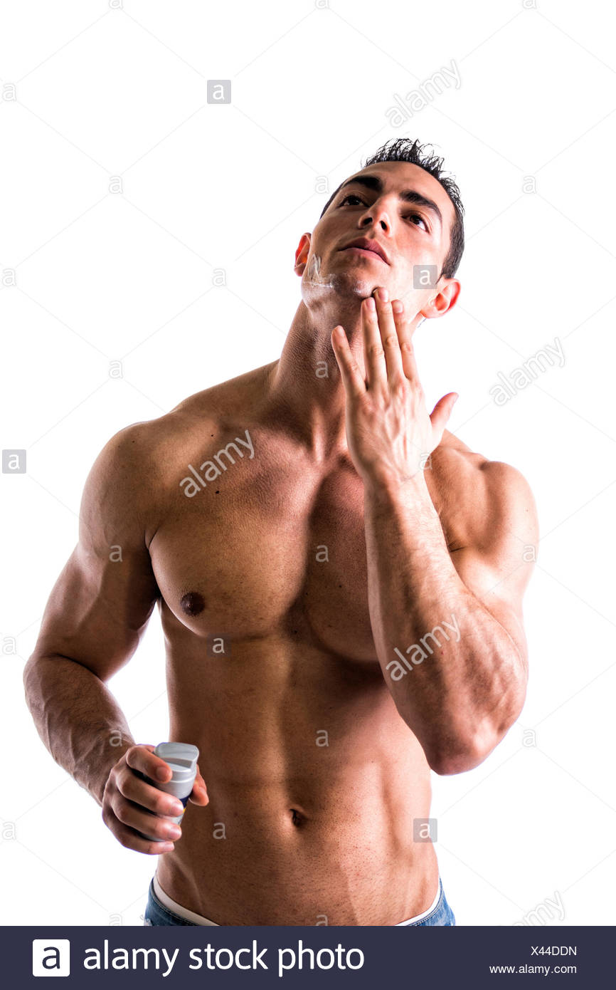 Man With Muscular Chest And Abs Applying Shaving Cream On His Face