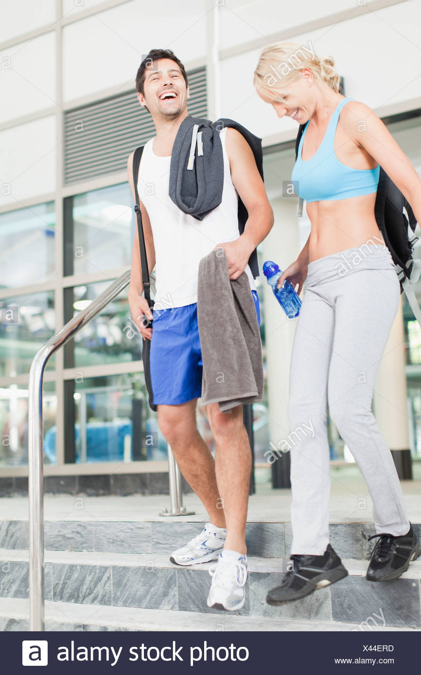 Couple walking on gym steps together Stock Photo