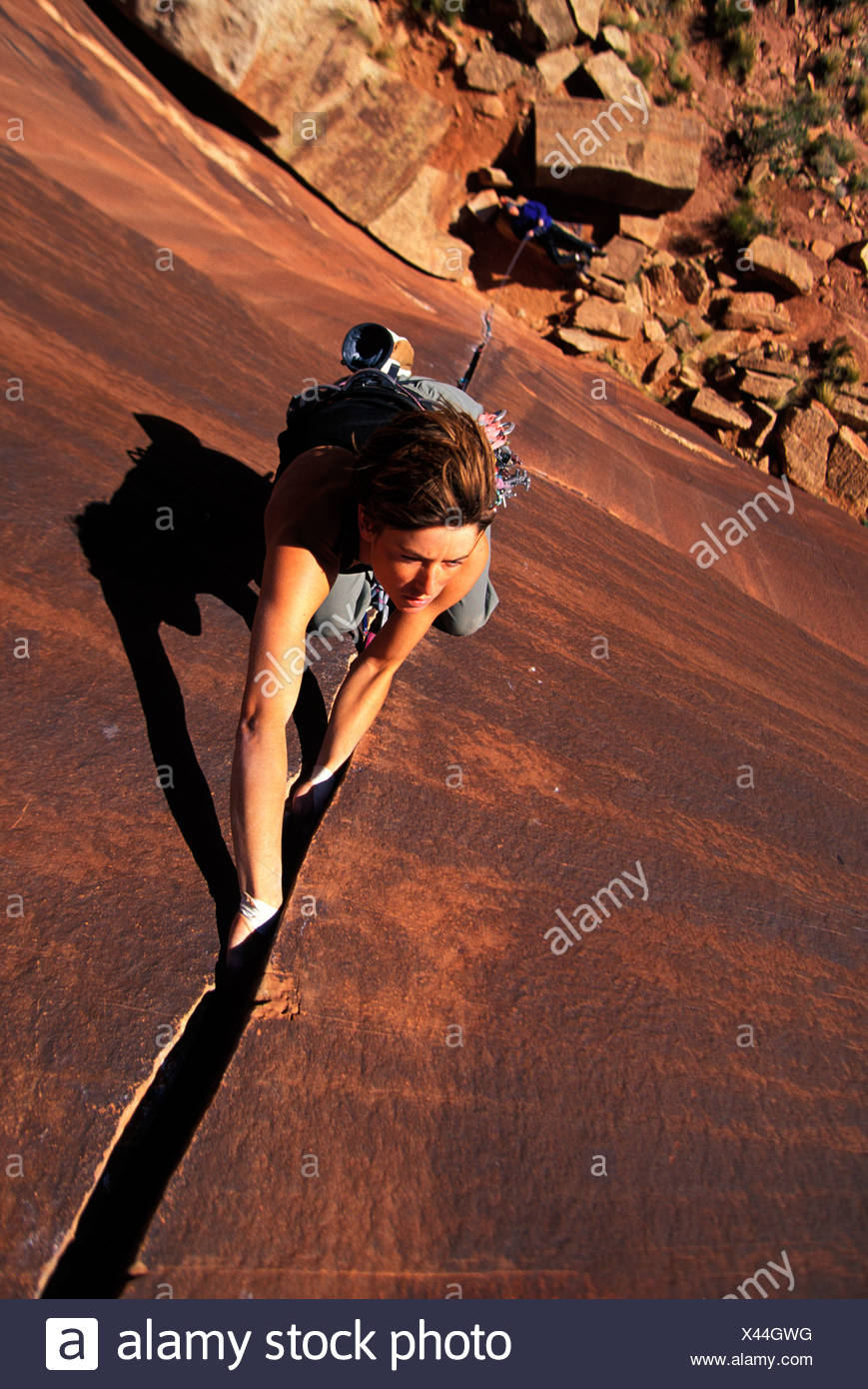 Female crack climbing (High Angle Perspective). - Stock Image