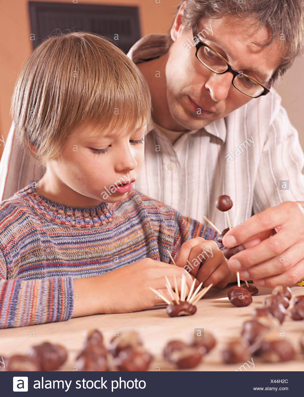 Father and son doing craft - Stock Image