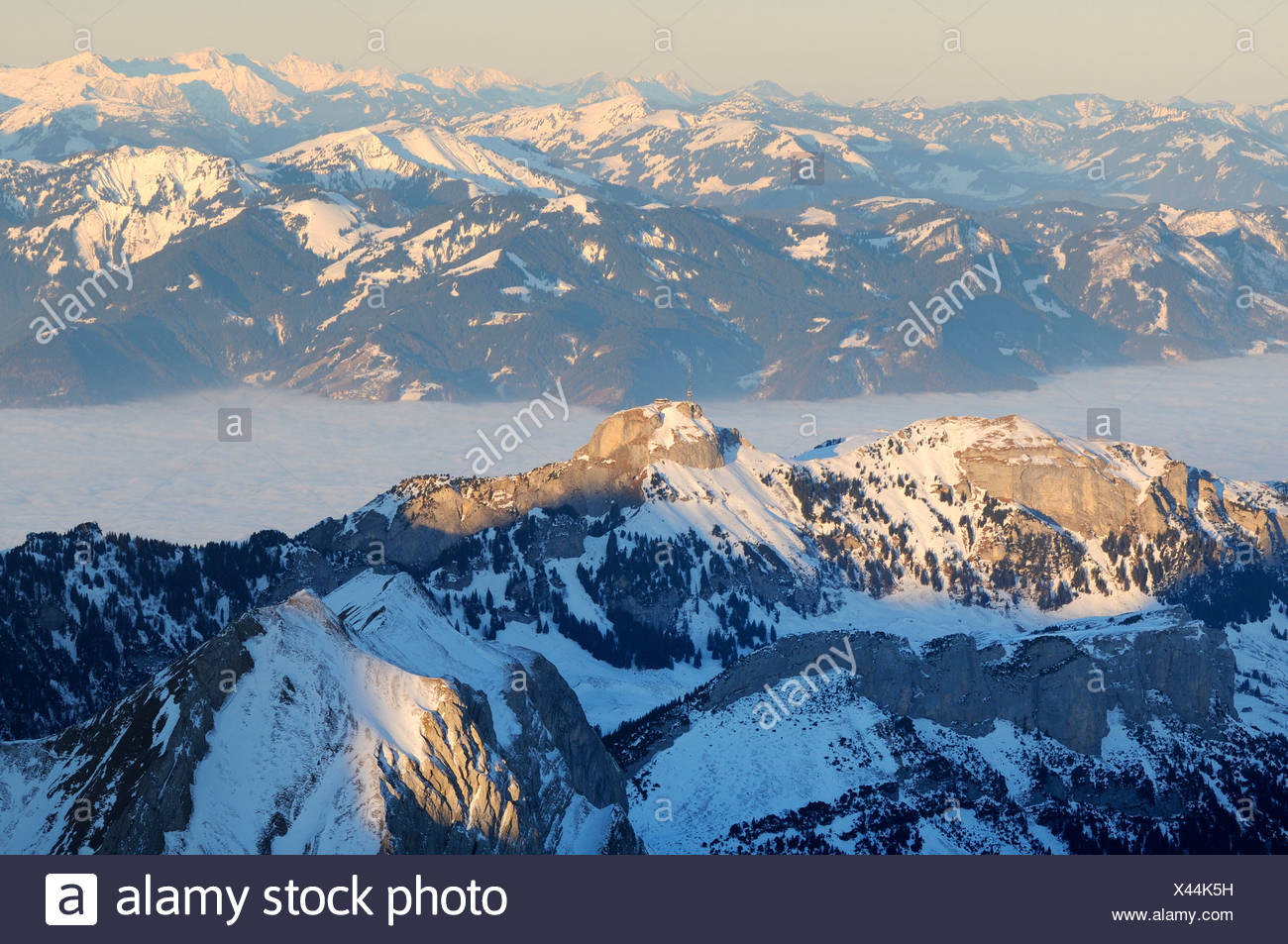 Mt Altmann and Mt Hoher Kasten in last daylight, between them the foggy Rheintal Valley, Canton of Appenzell Innerrhoden, Switz - Stock Image