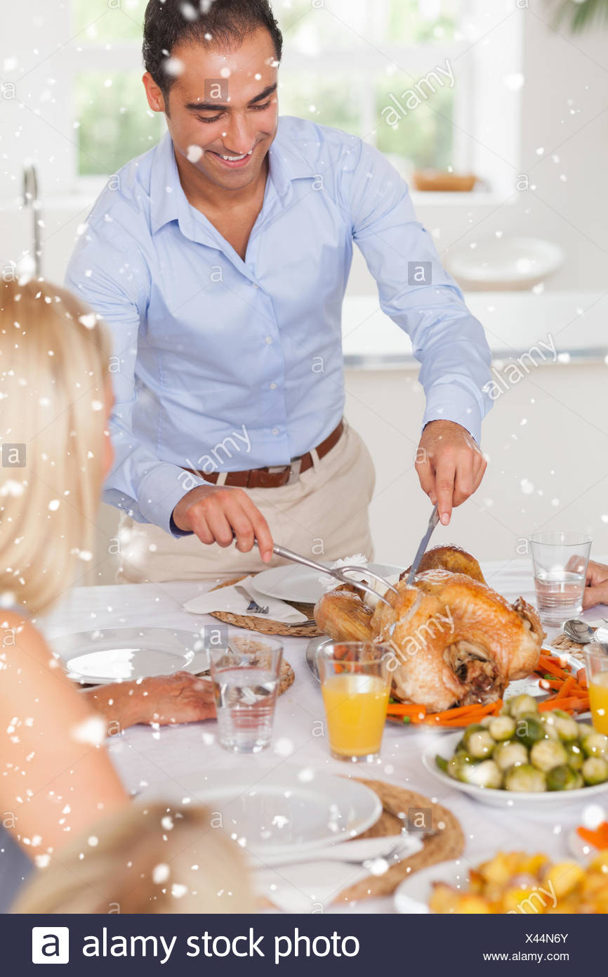 Man standing to carve the turkey - Stock Image