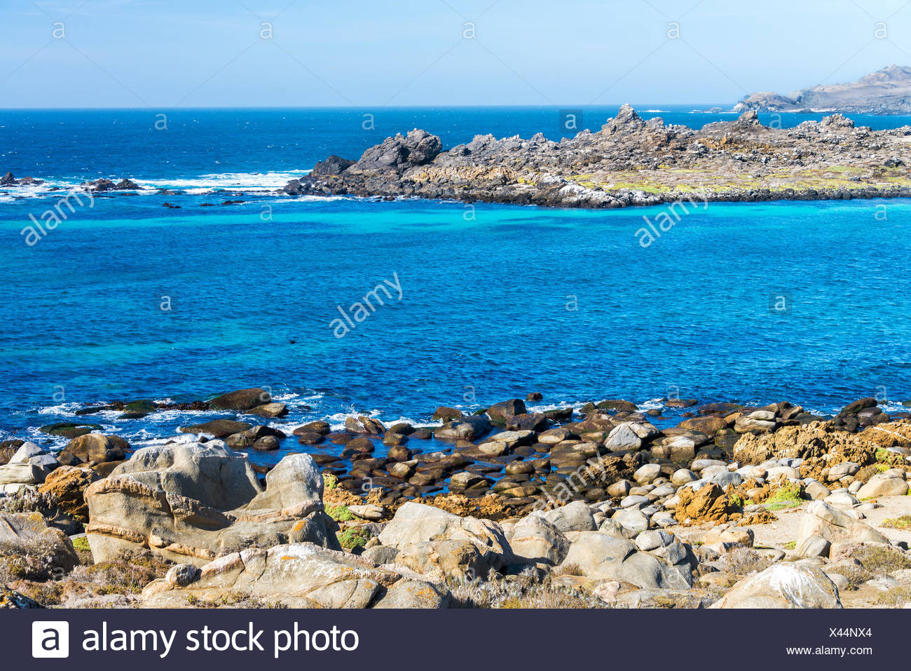 Beautiful blue water of the Pacific Ocean at Damas Island in Chile Stock Photo