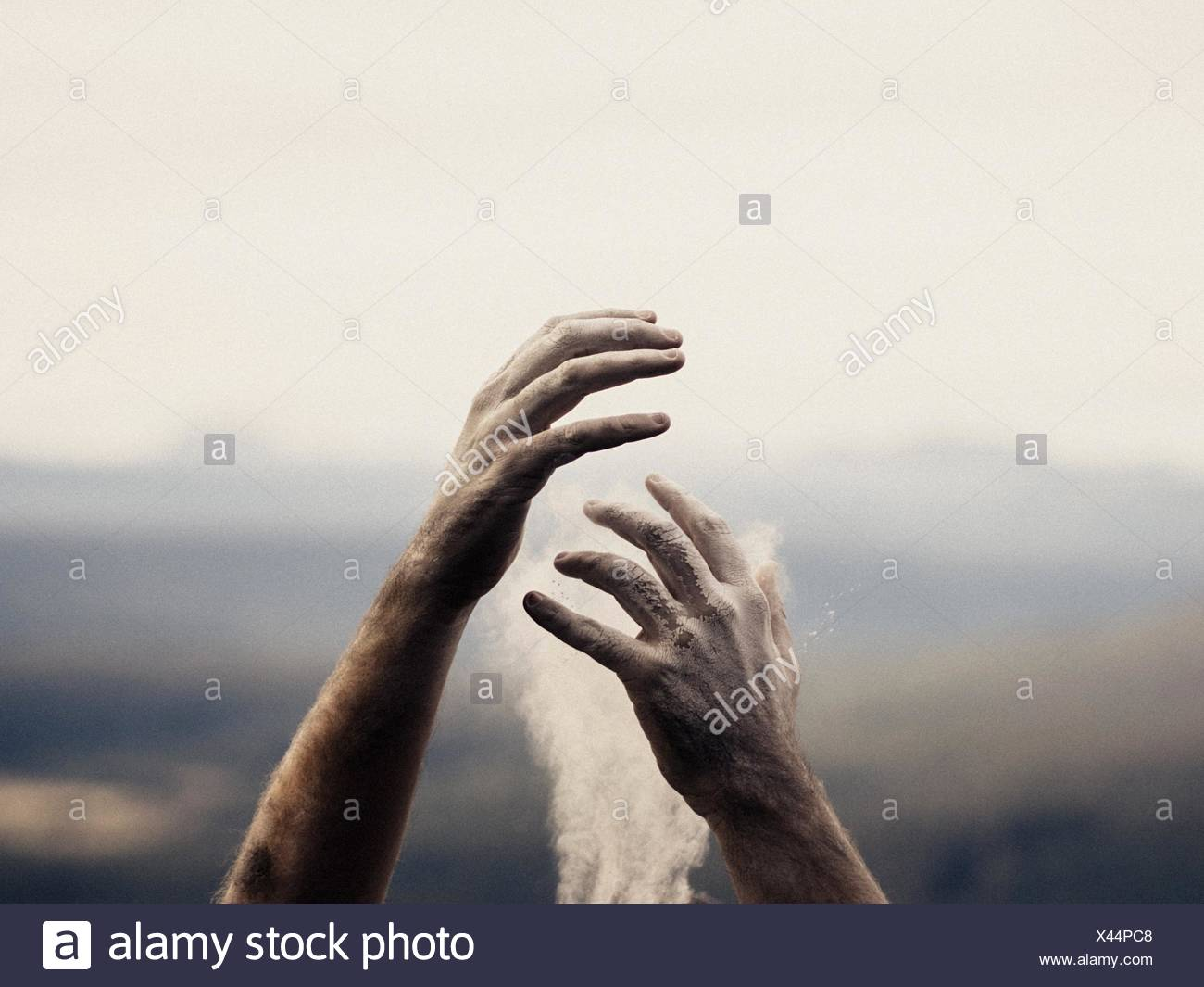 Cropped Hand Touching Smoke - Stock Image