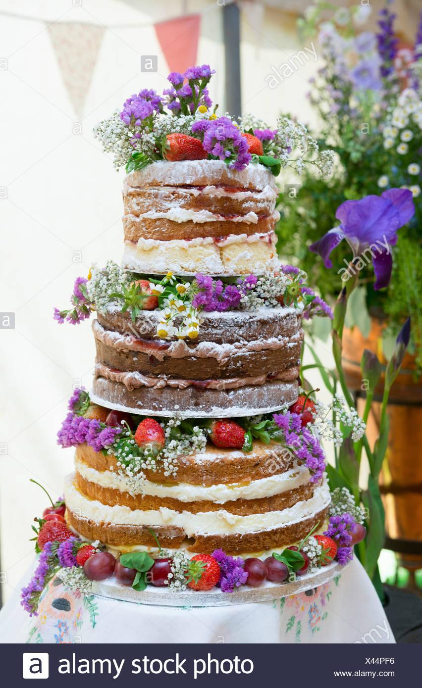 A handmade sponge wedding cake - Stock Image