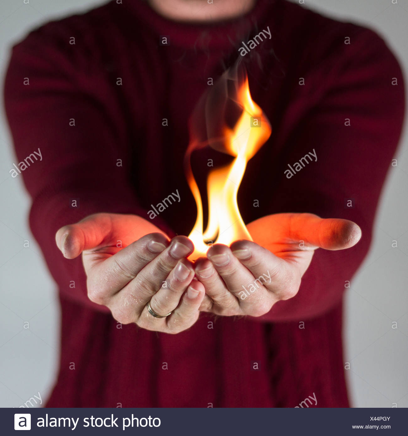 Man holding fire - Stock Image