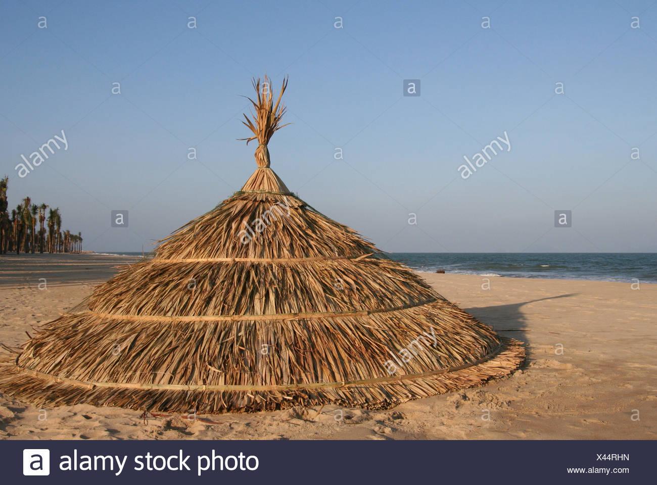 e8795041468 hat beach seaside the beach seashore sunshade bamboo viet nam vietnam  umbrella - Stock Image
