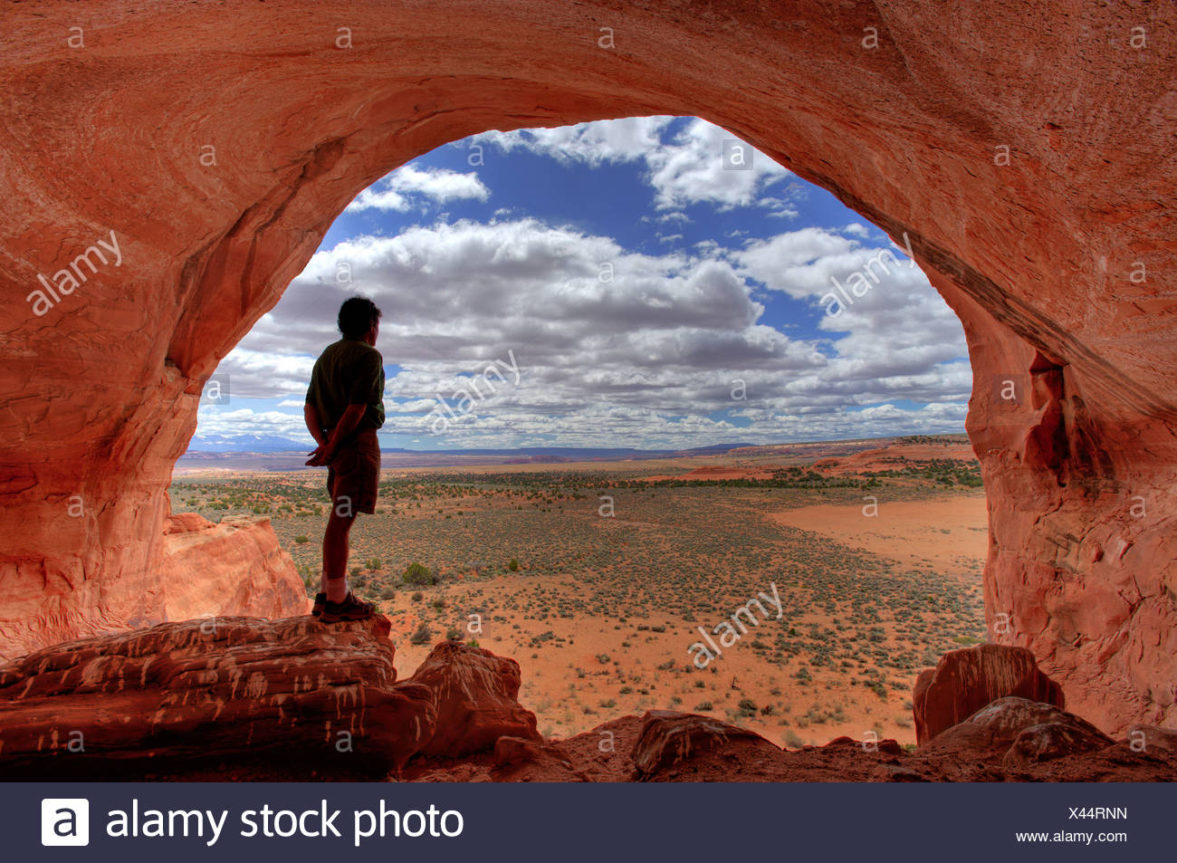 Man enjoys the view at Looking Glass Rock near Moab, Utah, USA - Stock Image
