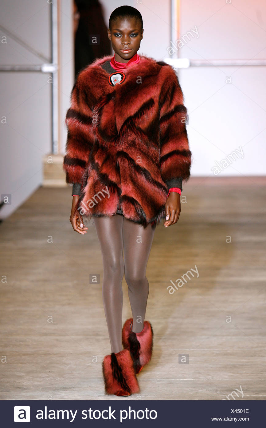Black and red short fur coat and matching ankle boots - Stock Image