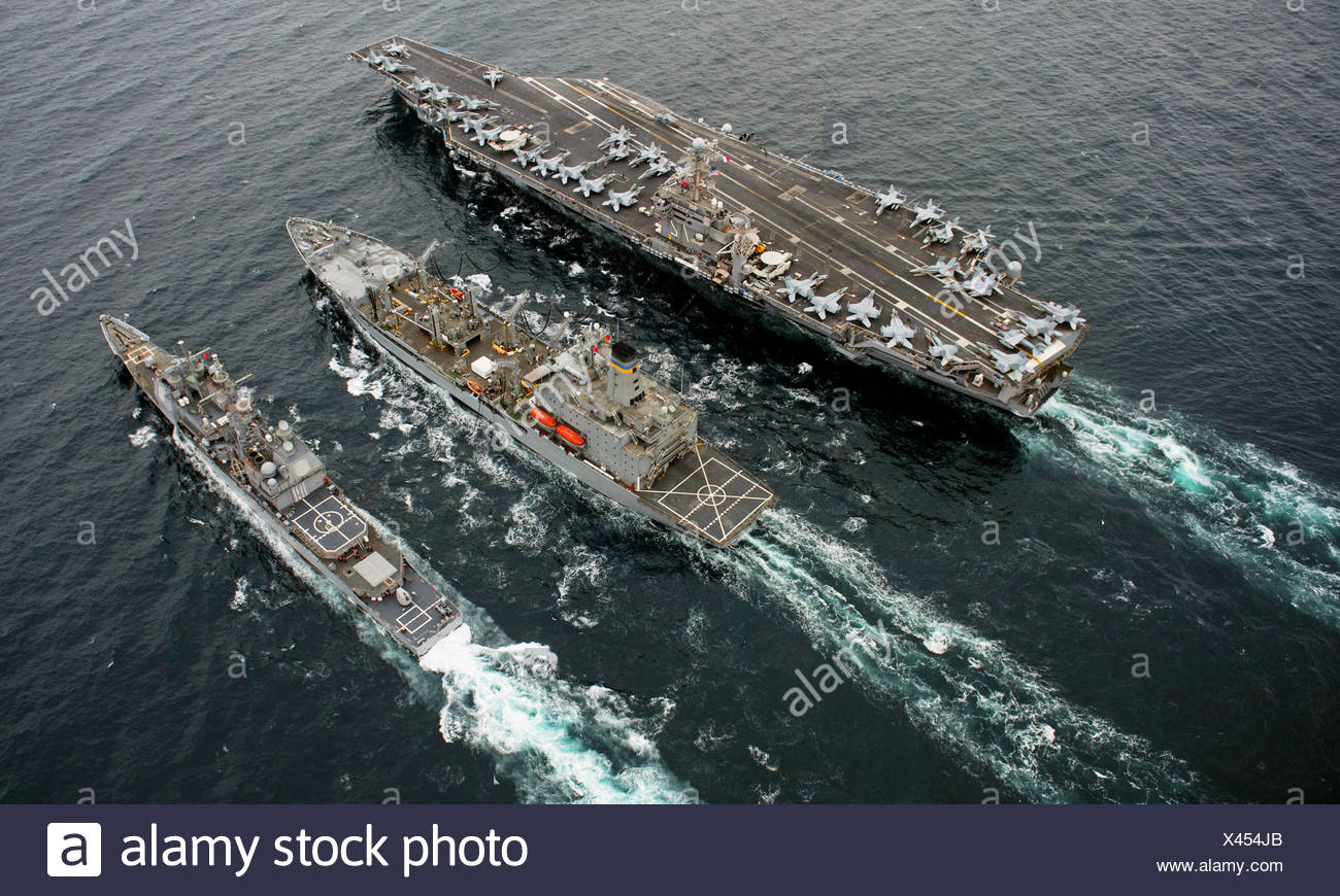 PACIFIC OCEAN (Sept. 26, 2011) The Nimitz-class aircraft carrier USS Abraham Lincoln (CVN 72), left, the Military Sealift - Stock Image