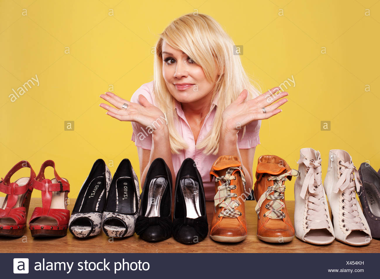release date: 8346b 564f6 Blonde lady with a passion for shoes looking at part of her ...