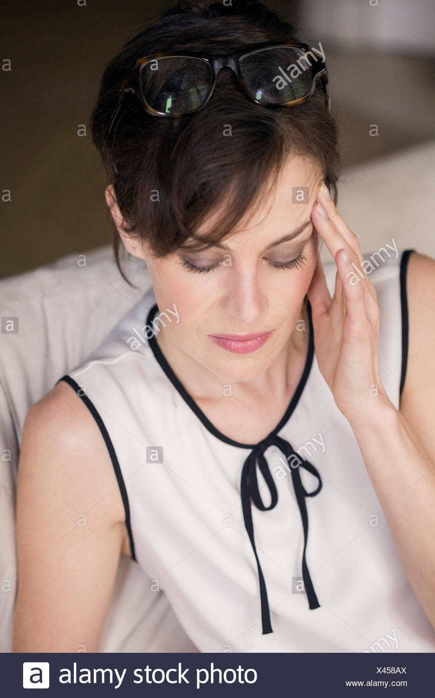 Woman suffering from headache - Stock Image