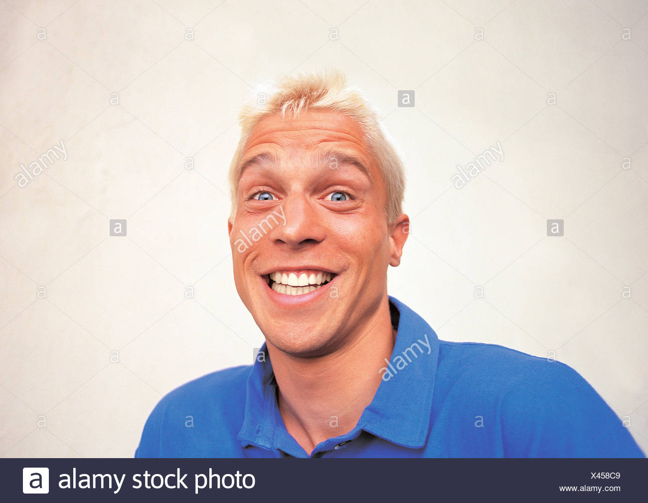 young man laughing make grimace - Stock Image