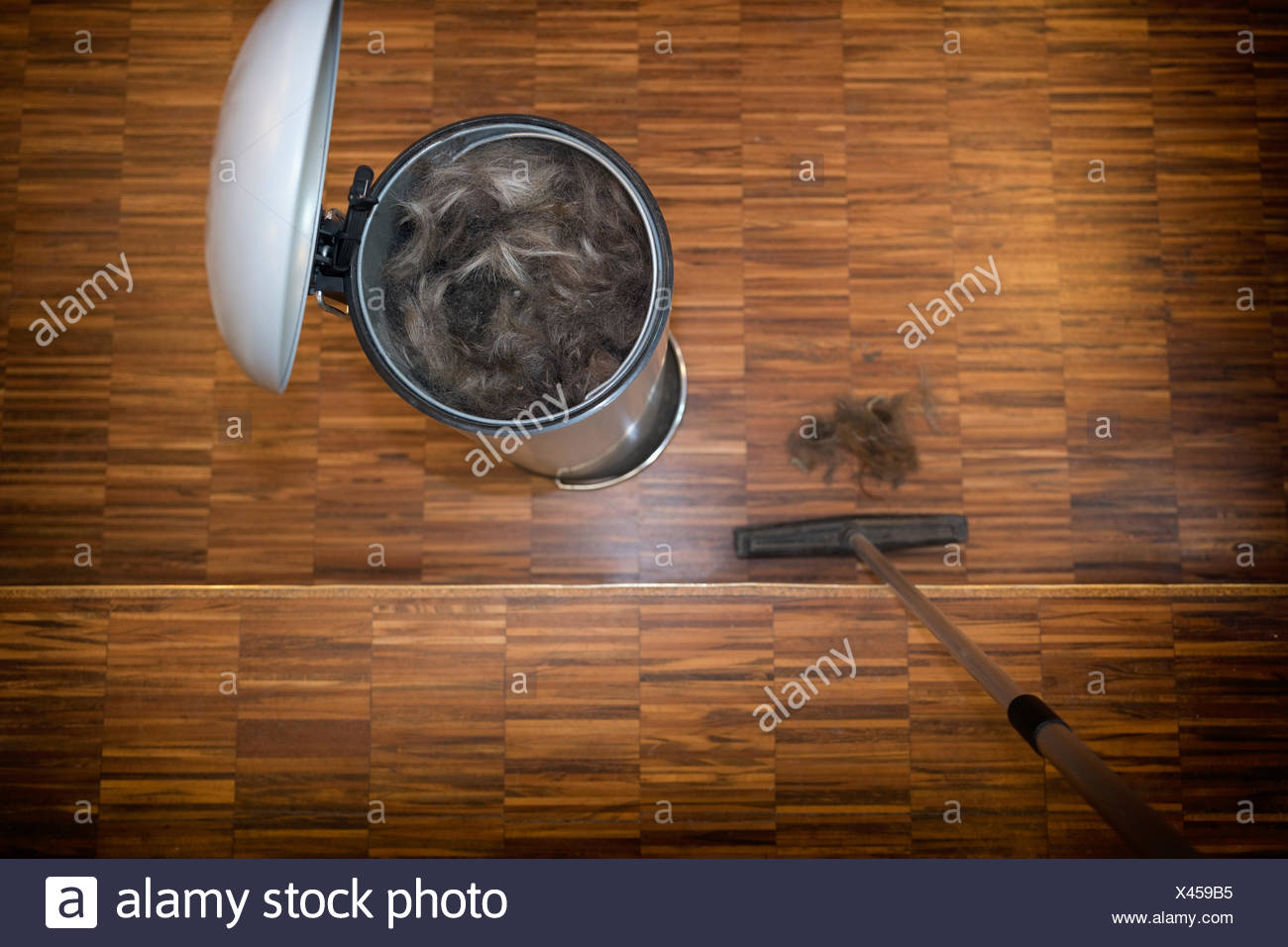 Hair clippings bin haircut off haircut garbage - Stock Image