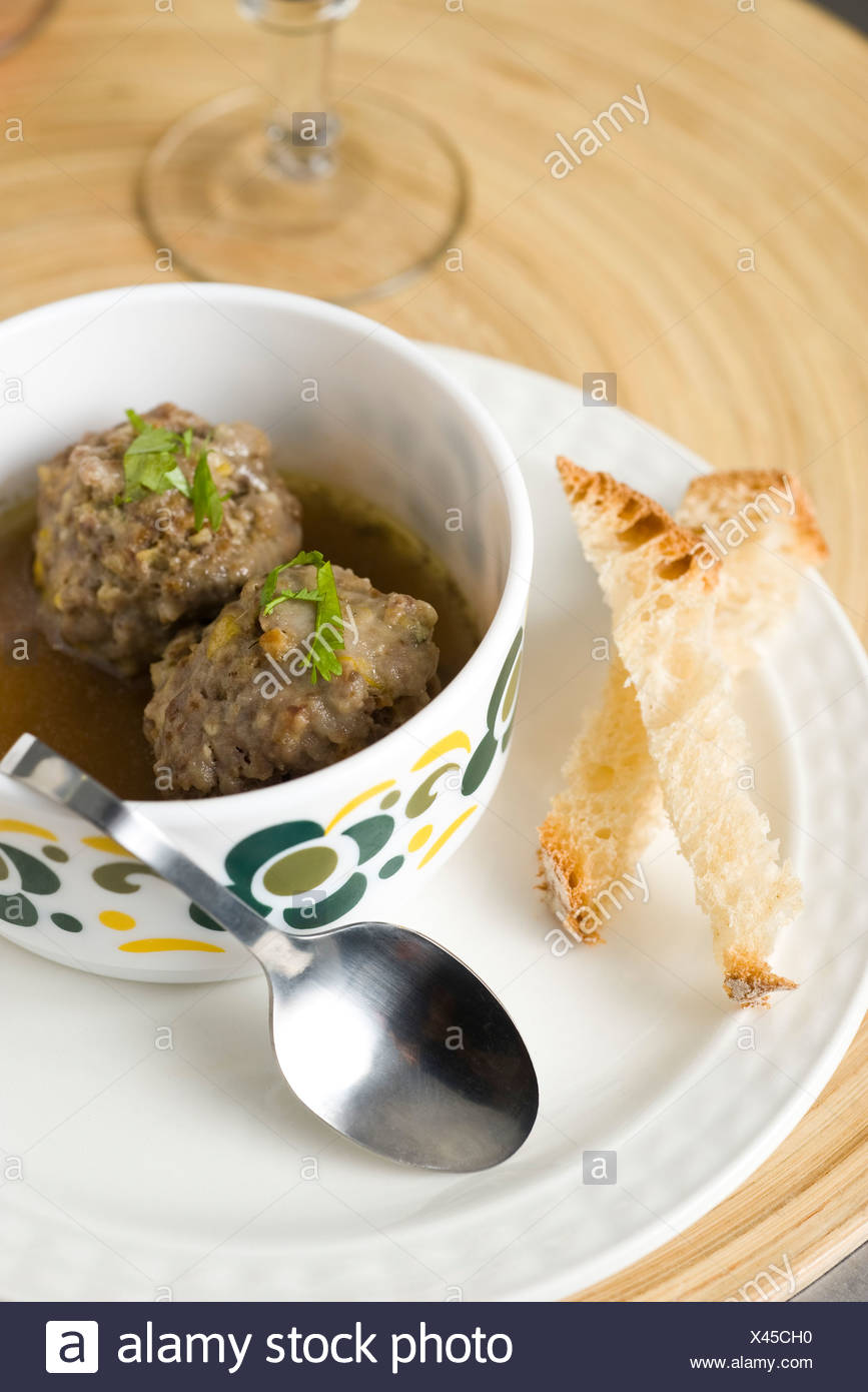 Poached meatballs with sage and lemon - Stock Image
