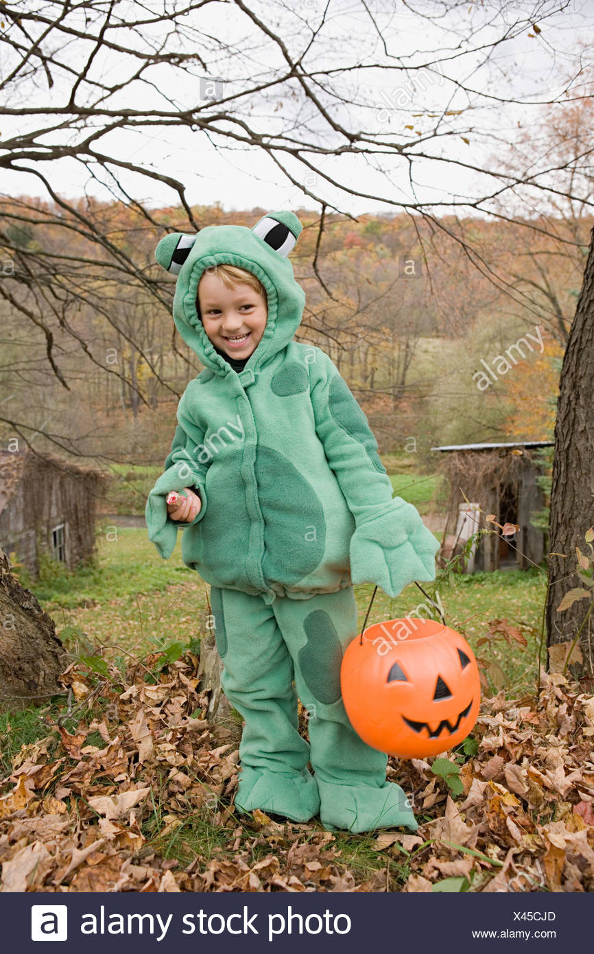 Boy in a frog costume - Stock Image
