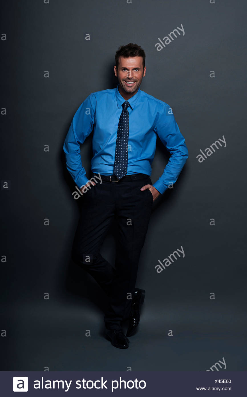 Relaxed and confident businessman looking at camera Debica, Poland - Stock Image