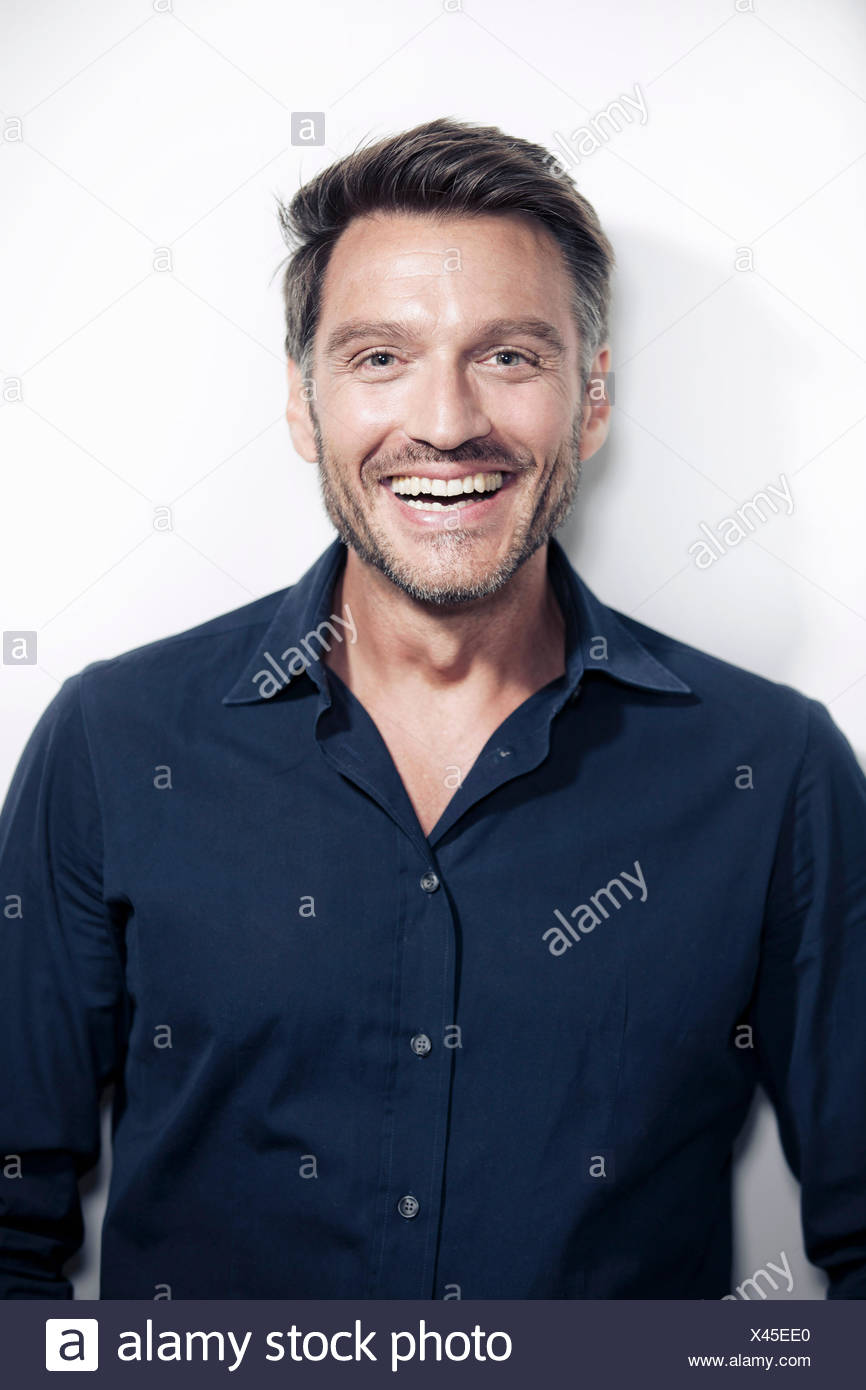 Portrait of mature man smiling - Stock Image