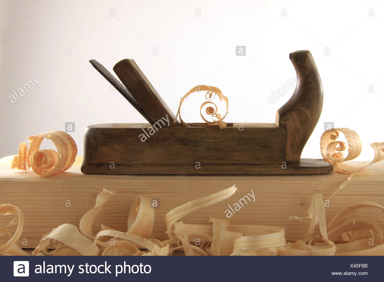 Antique plane with wood shavings Stock Photo