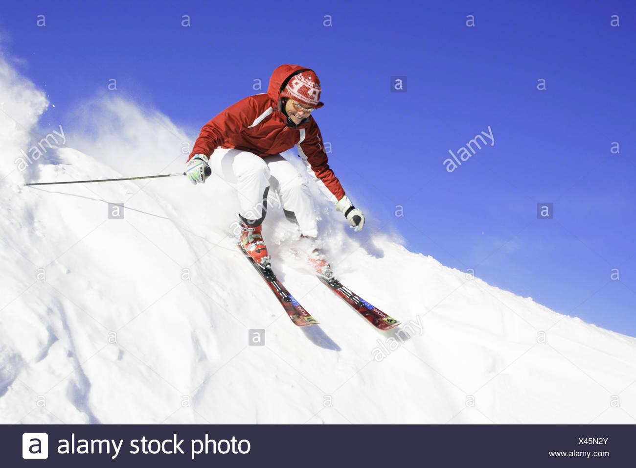 skier racing downhill, Austria, Alps - Stock Image