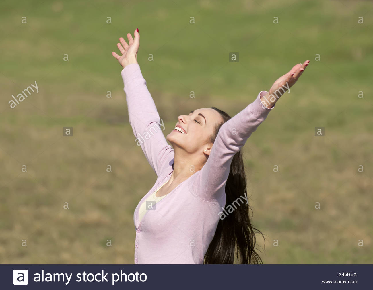smiling woman rejoicing Stock Photo