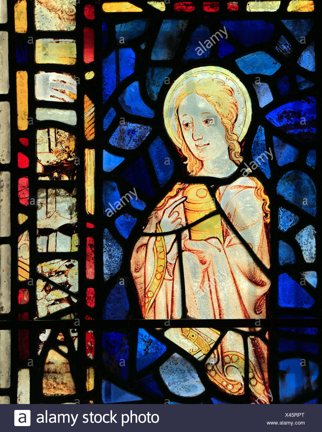 St. Mary Magdalene, holding jar of ointment, medieval stained glass window, Burnham Deeepdale, Norfolk England UK saint saints - Stock Image