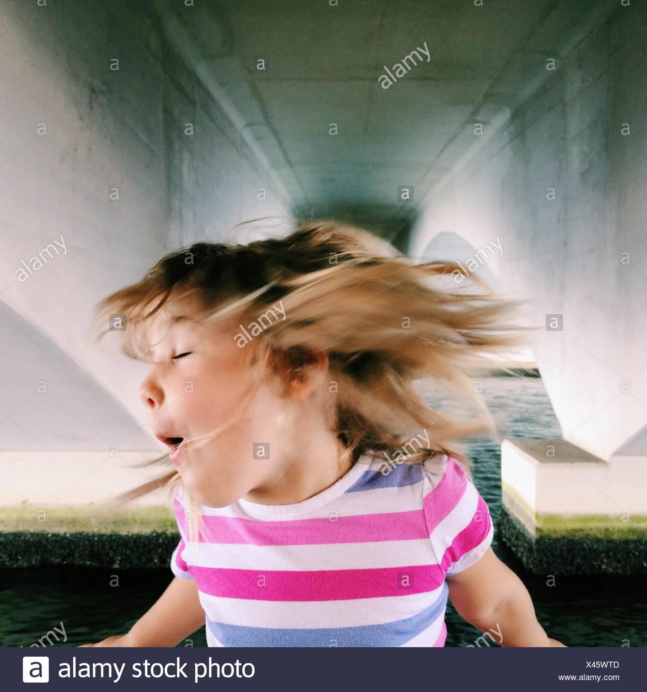 USA, Florida, Palm Beach County, West Palm Beach, Girl (2-3) shaking head - Stock Image