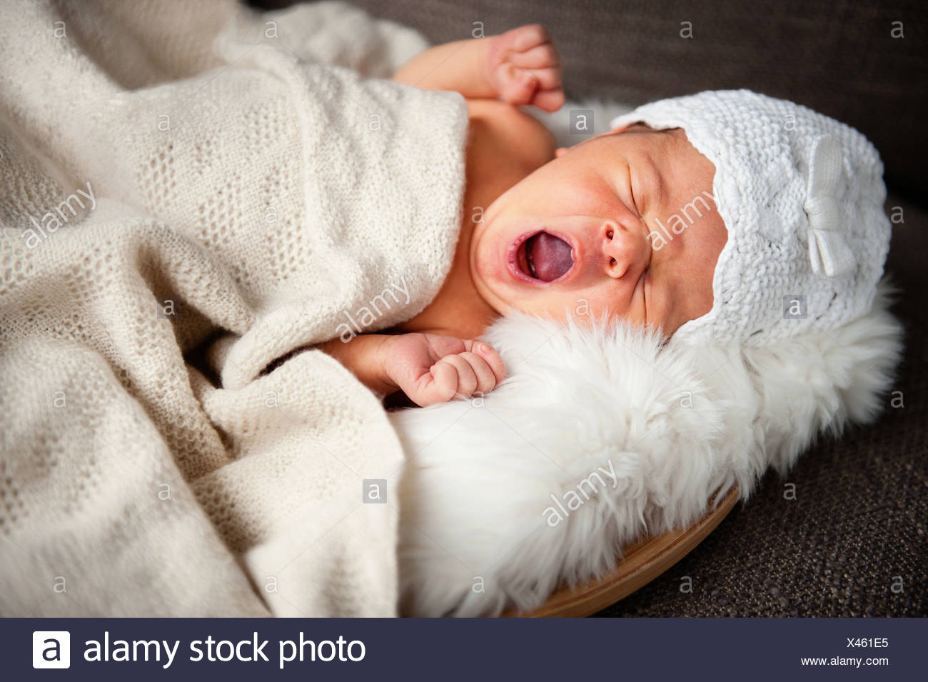Portrait of newborn baby girl yawning Stock Photo