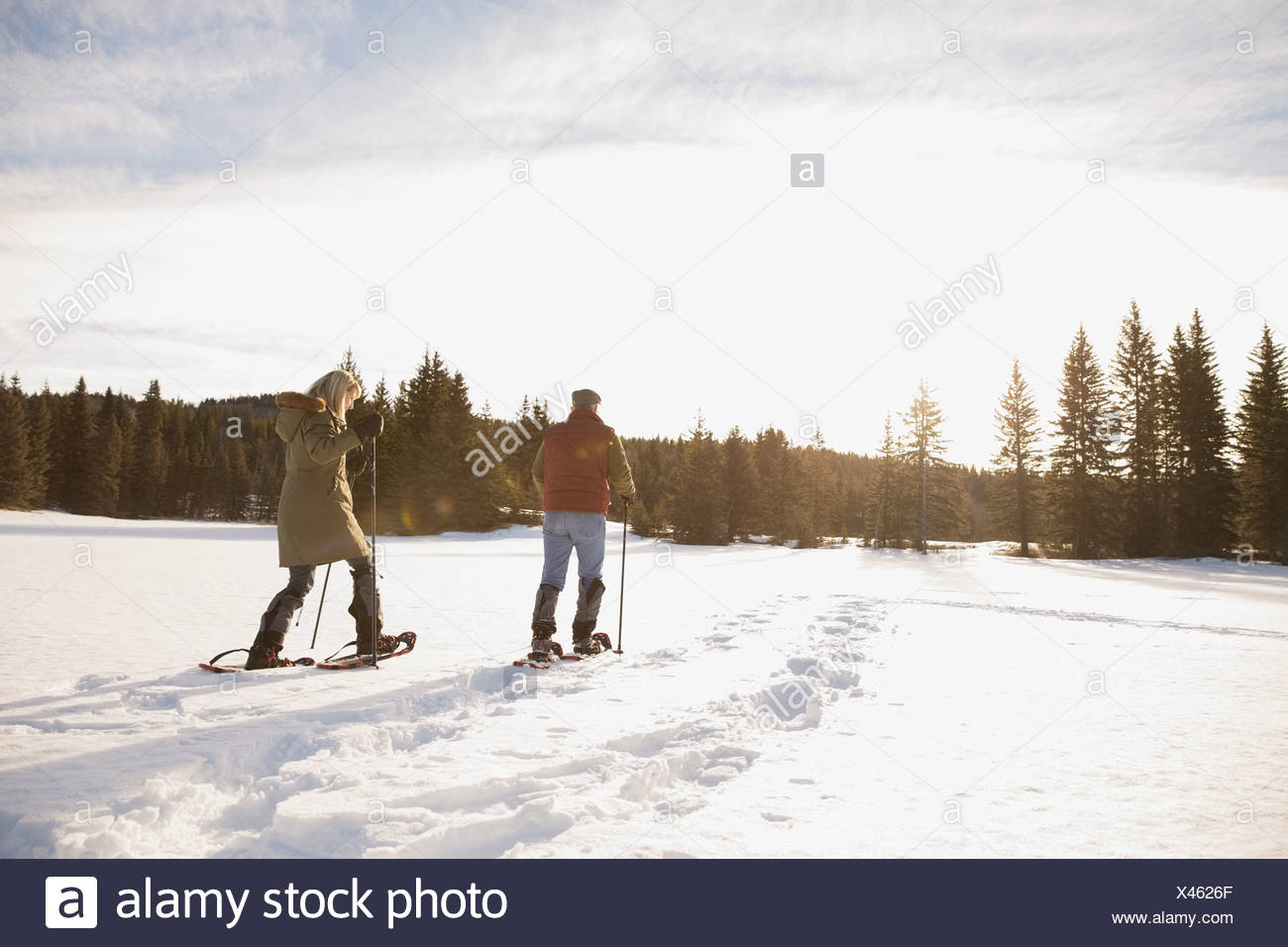 Mature couple snowshoeing - Stock Image