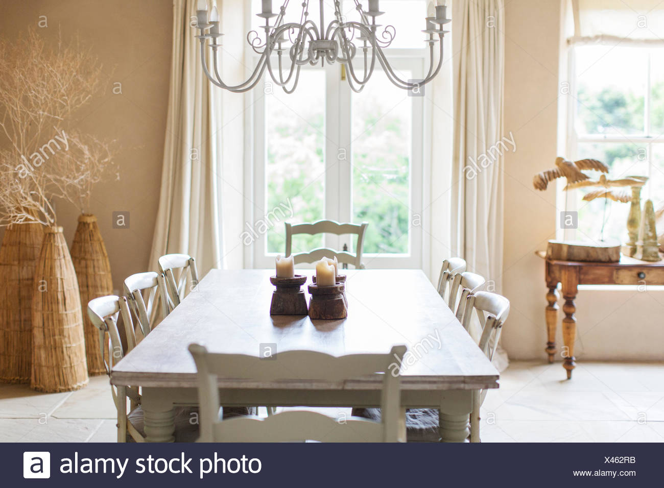 Dining table in rustic house - Stock Image