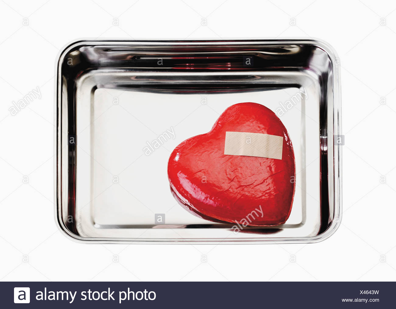 Heart with bandage in tray - Stock Image